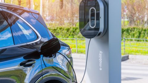 Refueling,For,Cars,E-mobility.,Charging,An,Electric,Car,At,Hybrid